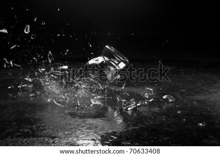 A glass breaking on the ground - stock photo