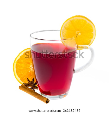A glass cup of red tea with lemon, orange and various spices. Isolated on a white background closeup