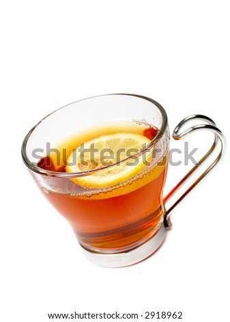 A glass cup of tea with one slice of lemon. Soft shadow and shallow dof