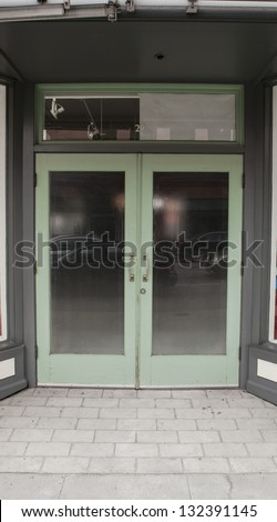 A glass double door entry on the street.