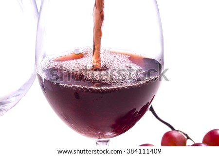 a glass filled with wine - stock photo
