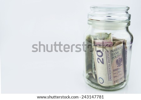 A glass jar full of Polish money.  - stock photo