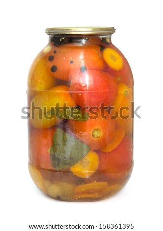 A glass jar of canned tomatoes on white background