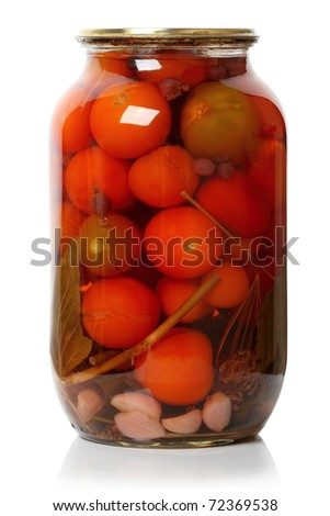 A glass jar of canned tomatoes on white background. Series of canned foods