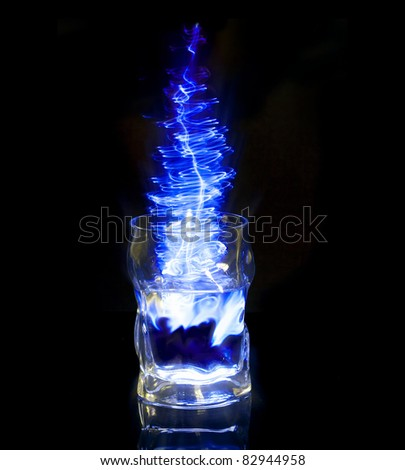 a glass of a blue energy drink - stock photo