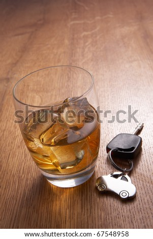 A glass of alcohol and car keys - stock photo