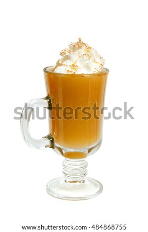 a glass of Apple puree with whipped cream and cinnamon