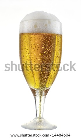 A glass of beer with water drops and foam