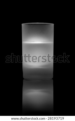 A glass of beverage on a glass table - stock photo