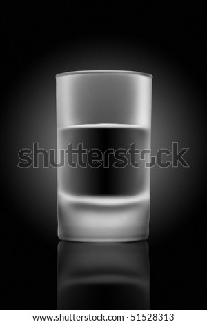 A glass of beverage on a glass table