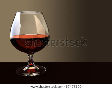 A glass of brandy on a dark background