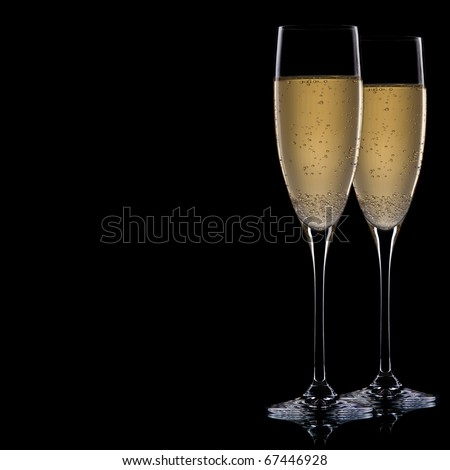 A glass of champagne, isolated on a black  background. - stock photo