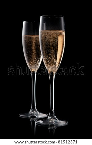 A glass of champagne, isolated on a yellow  background.