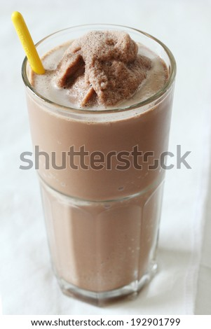 a glass of chocolate smoothies on white background  - stock photo