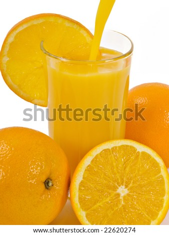 A glass of cold Orange Juice and Oranges - stock photo