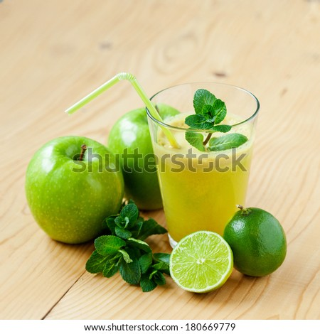 A glass of fresh apple, lime and mint juice, shallow depth of field - stock photo