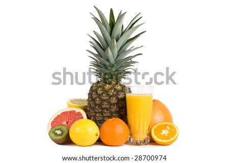 A glass of fruit juice surrounded by fresh citrus fruits - stock photo