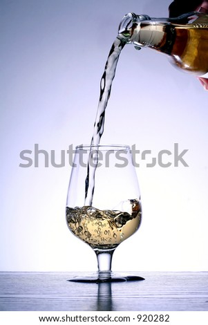 a glass of gold beverage - stock photo