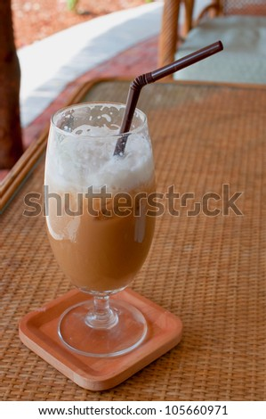 a glass of ice coffee on the table - stock photo