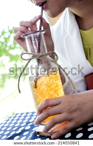 a glass of ice tea in the garden