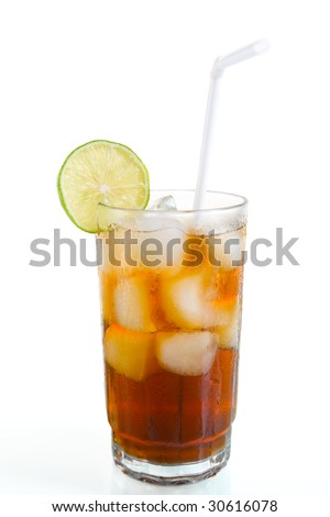 A glass of ice tea or cola with sliced lime and straw, isolated on white