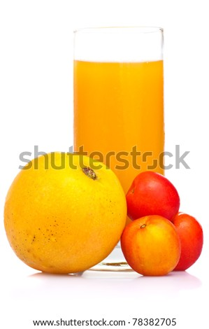A glass of juice with assorted tropical fruits on a white background - stock photo