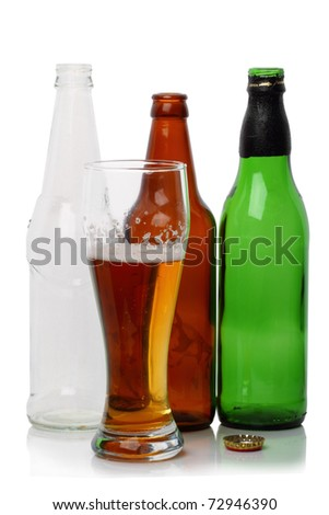 A glass of light beer and three empty bottles isolated on white background