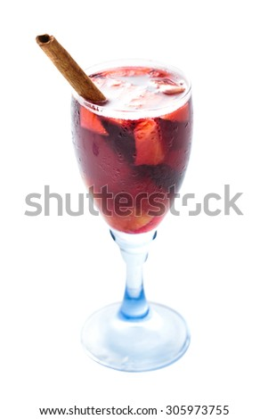 a glass of red sangria with cinnamon isolated on white background - stock photo