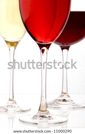 a glass of red,white and rose wine