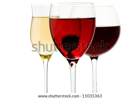 a glass of red, white and rose wine