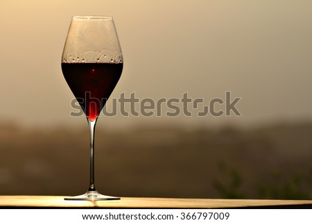 A glass of red wine. - stock photo