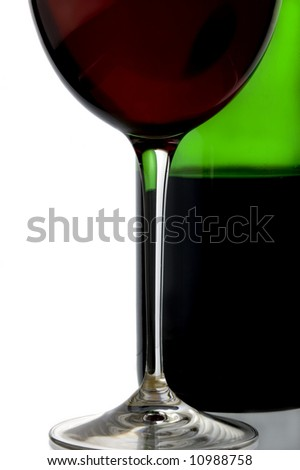 a glass of red wine and a bottle