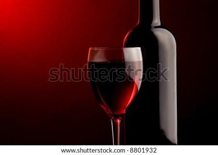 a glass of red wine and a bottle details