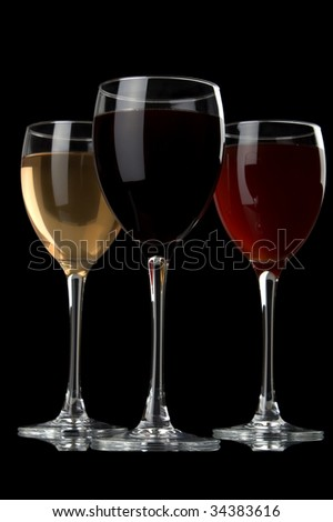 a glass of red wine and a white wine at black background
