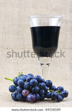 a glass of red wine and grape - stock photo