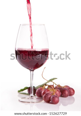a glass of red wine and grape isolated on white background - stock photo