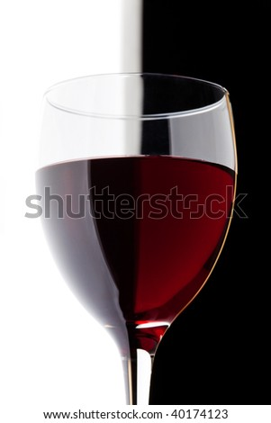 a glass of red wine detail on black and white