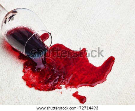 A glass of red wine was spilled on a carpet. Damage insurance. - stock photo