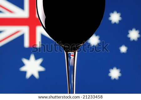 A glass of red wine, with an Australian flag background.