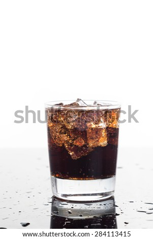A glass of refreshing cold fizzy cola drinks on vertical format - stock photo