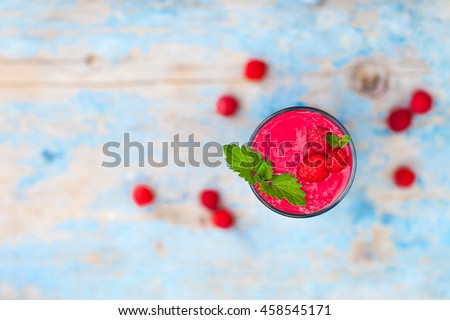 A glass of smoothie raspberry, top view
