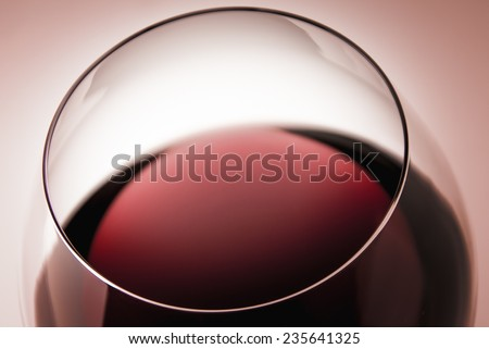 A glass of sophisticated sicilian Marsala wine on graduated homogenic background,in the color of the year 2015, Marsala 18-1438 toned photo - stock photo