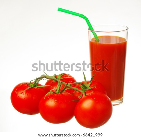 A glass of tomato juice and five fresh tomatoes.