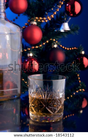 a glass of whiskey and Christmas tree