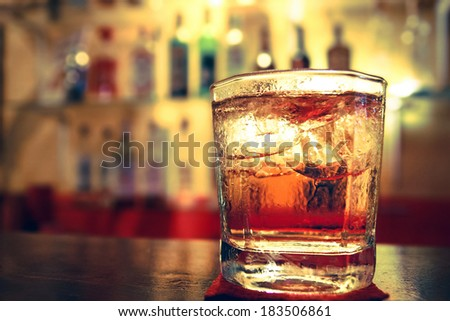 a Glass of whisky on the bar - stock photo