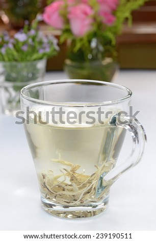 A glass of White Snow Mountain Tea - stock photo