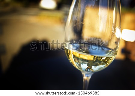 A glass of white wine in an isolated background. - stock photo