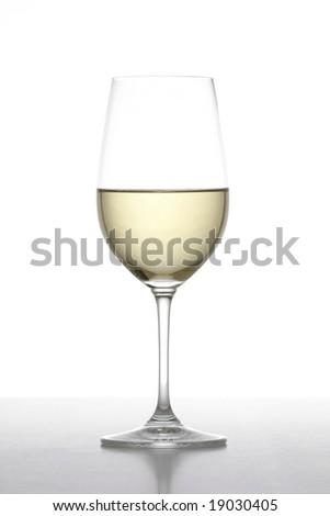 A glass of white wine in the studio - stock photo