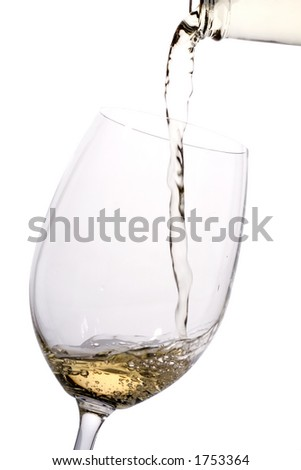 A glass of white wine is being poured
