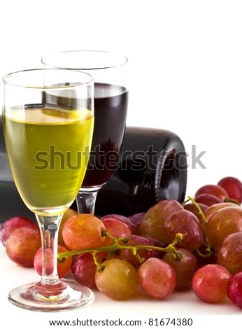 A glass of white wine, red wine and grapes on white background. - stock photo